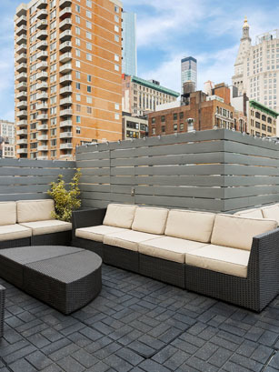 rooftop long couches with view of city buildings