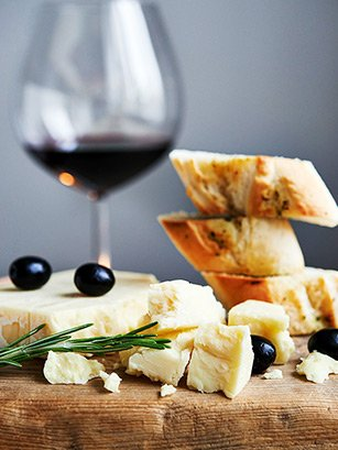 red wine, cheese, bread and olives