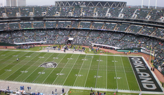 Oakland Raiders Stadium with fans in the stands and Raiders logo in the endzone