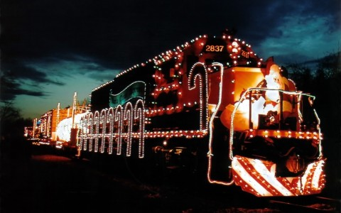 train decorated in Christmas lights
