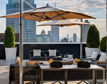 Champagne Suite terrace with seating area overlooking the skyline of new york city