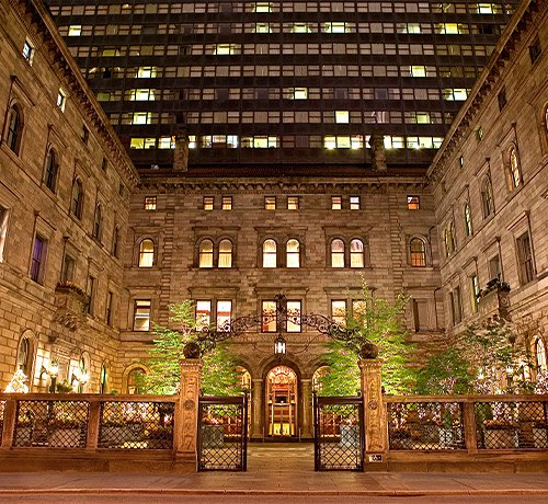 lotte new york palace courtyard at night