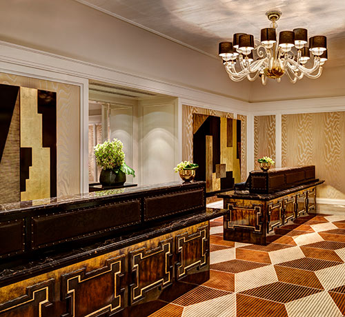 Lobby with wooden counters with golden accents