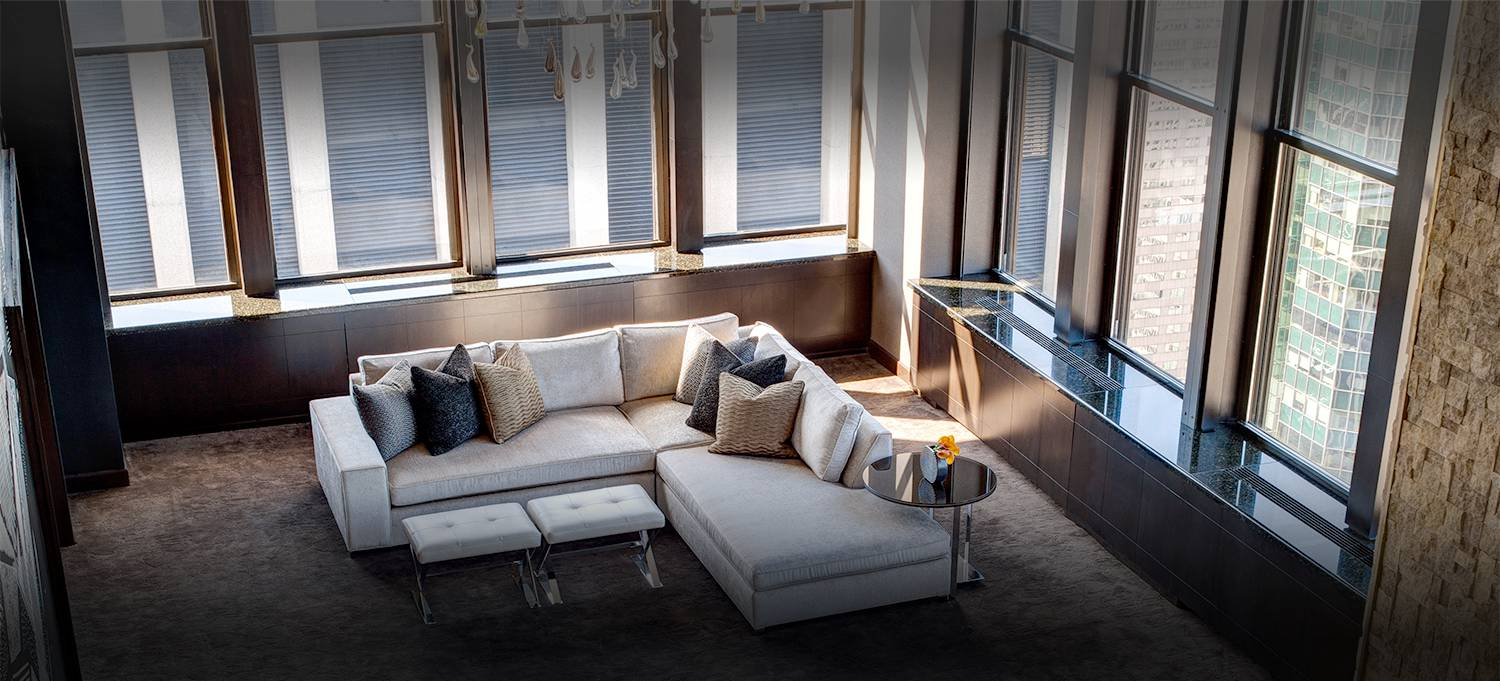 Champagne Suite sectional couch and wall to ceiling windows