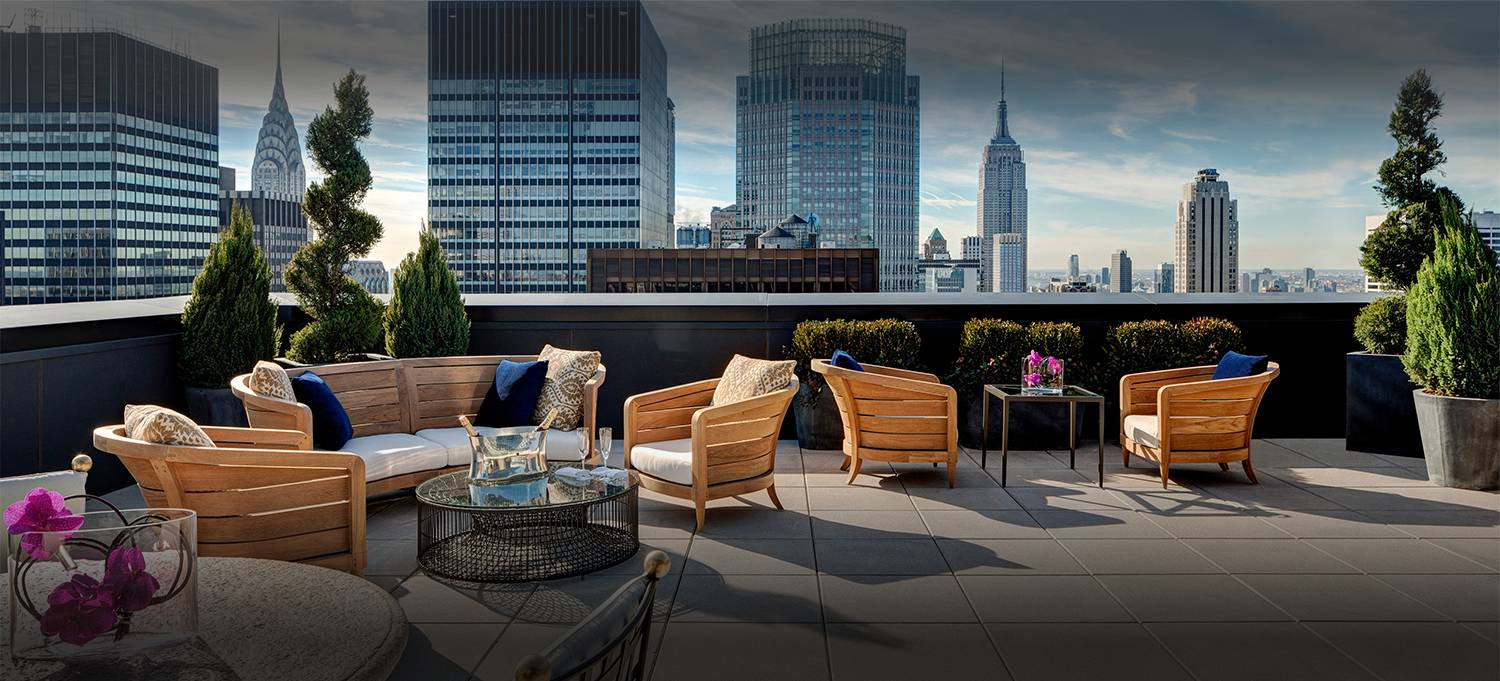 Jewel Suite terrace with seating area with new york city skyline views