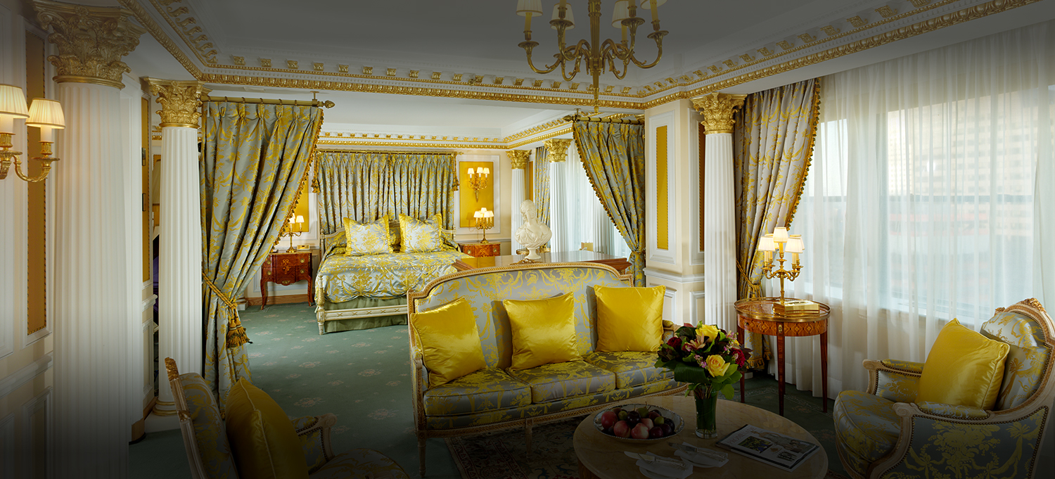 view of Royal Suite with love seat and master king sized bed