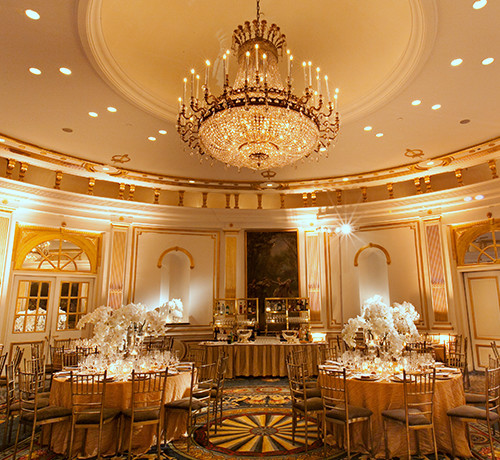 Reception Setup In With Ornate Chandelier And Round Tables