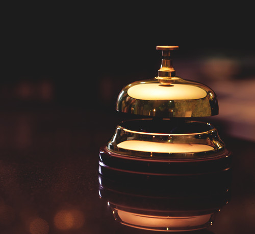 Gold bell on wooden desk