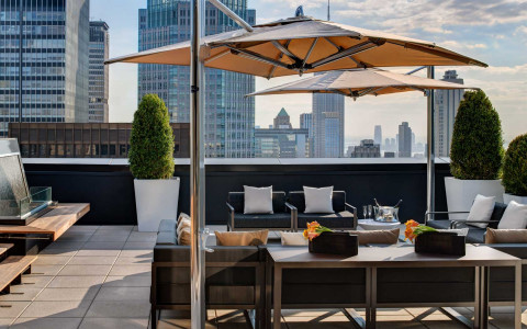The Towers terrace with outdoor seating and skyline views of new york city