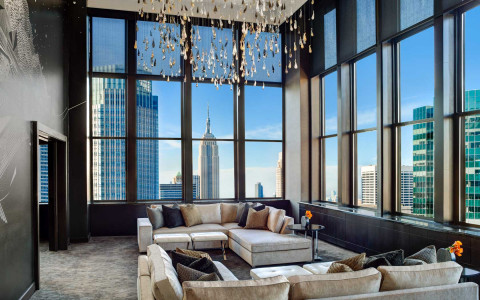 Lotte champagne suite overlooking empire state building with floor to ceiling windows