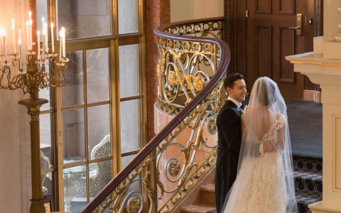 Bride and groom walking up staircase