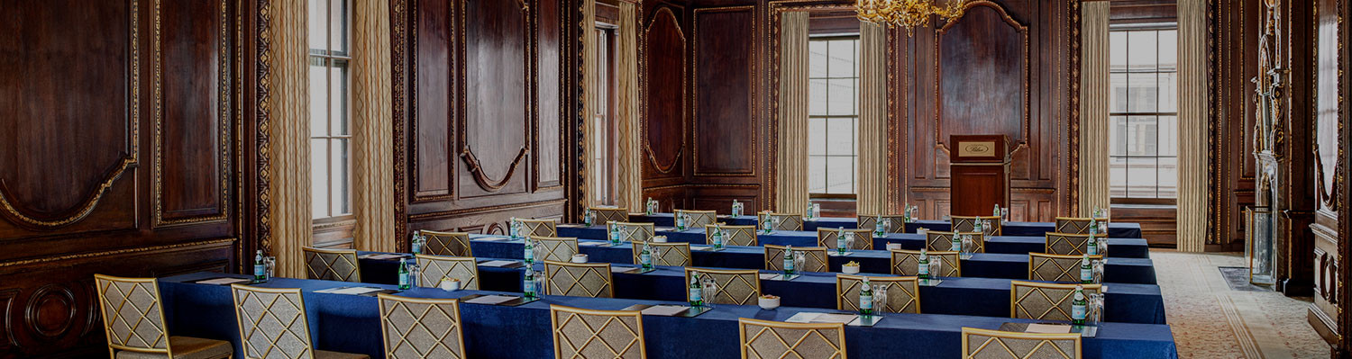 rows of blue chairs set up for presentation in the drawing room