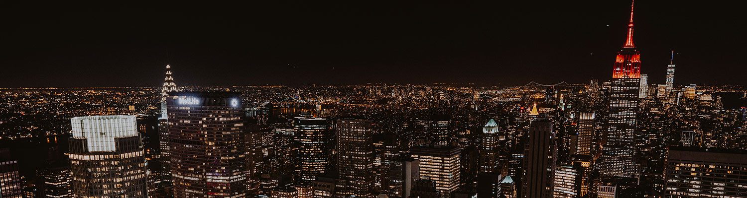 new york city skyline at night with city lights