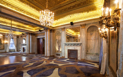 Marble floors with fireplace and chandelier