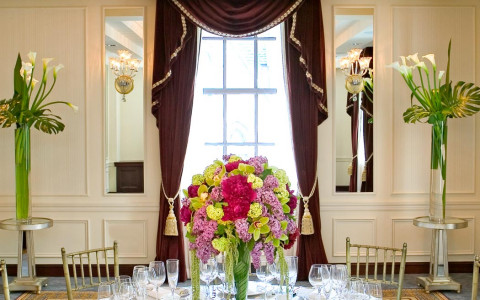 Elegant dining setup with flowers and window
