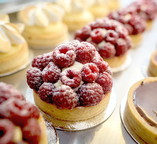 catered pastries with raspberries, chocolate, and meringue