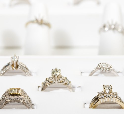 A display of 5 gold and diamond rings Inset