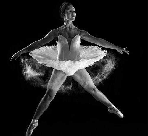 B&W picture of ballerina jumping into the air  Inset