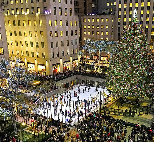 Aerial view of the skating rink at Rockefeller center filled with people ice skating Inset