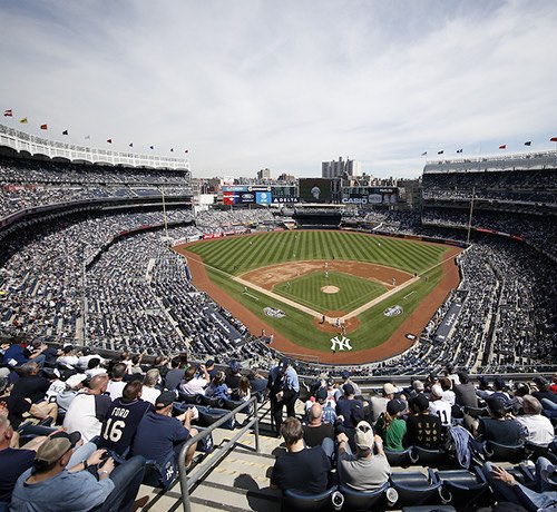 View of Yankee Stadium filled with a crowd from the top bleachers Inset