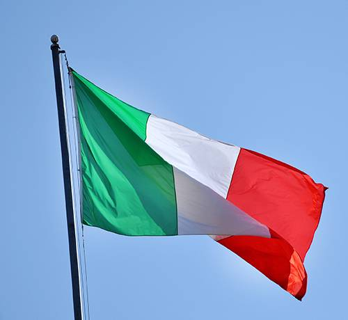 Italian flag waving in the sky