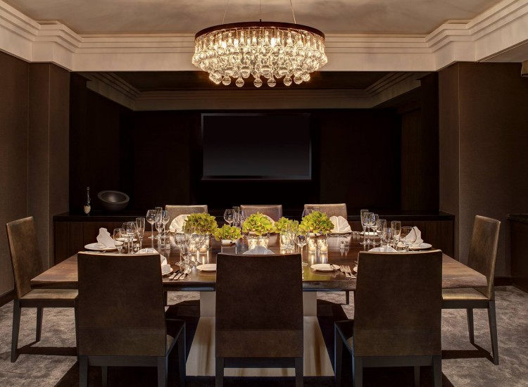 In room dining at Champagne suite with elegant crystal chandelier