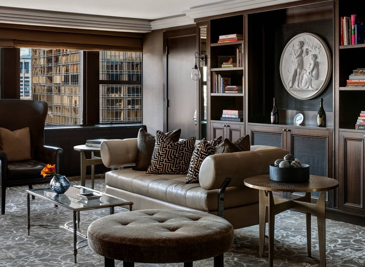 Champagne Suite living room with leather chairs & patterned pillows