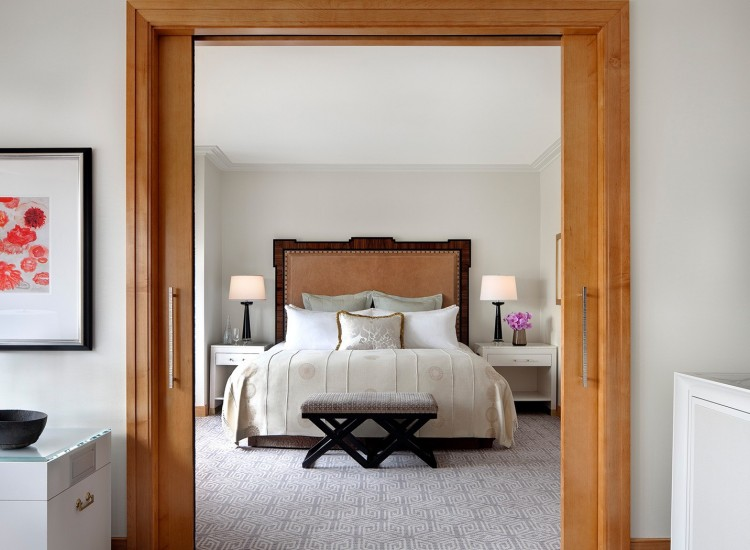 Wooden frame to bedroom entrance with king bed & nightstands
