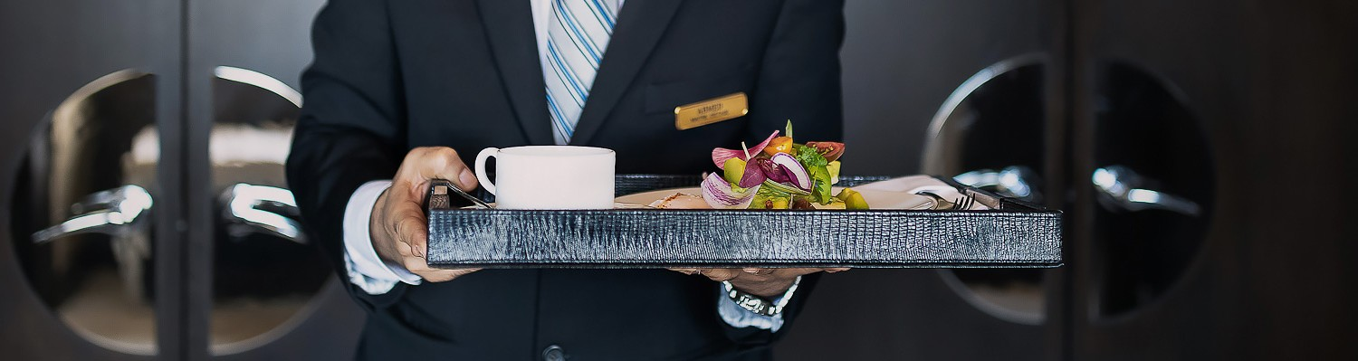 concierge carrying a tray