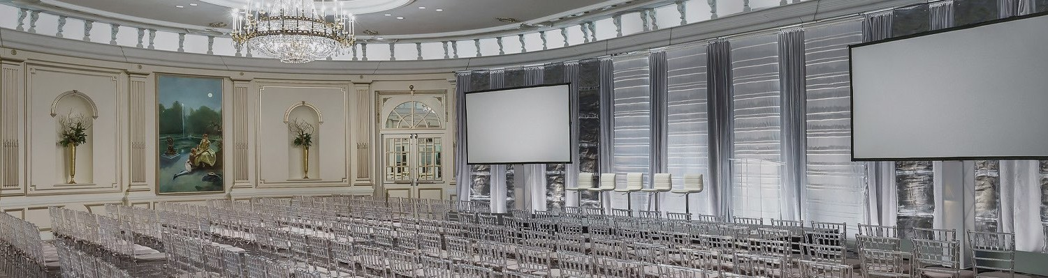 large meeting space with two projector screens