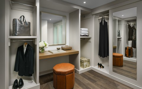 large closet with full length mirror and vanity area