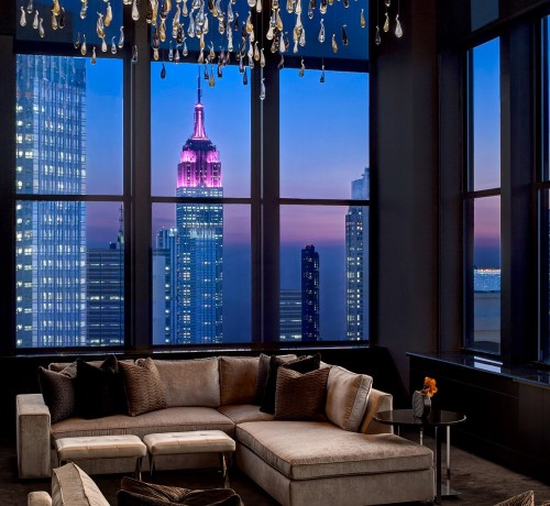 living room with night skyline view