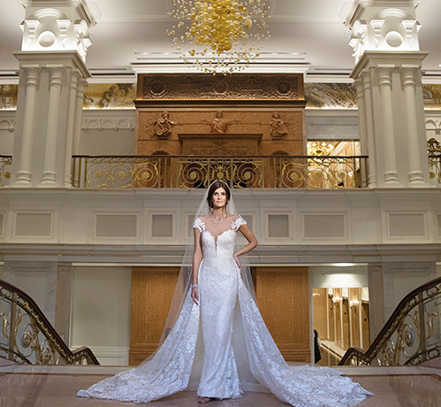 Bride posing in her elegant white wedding dress