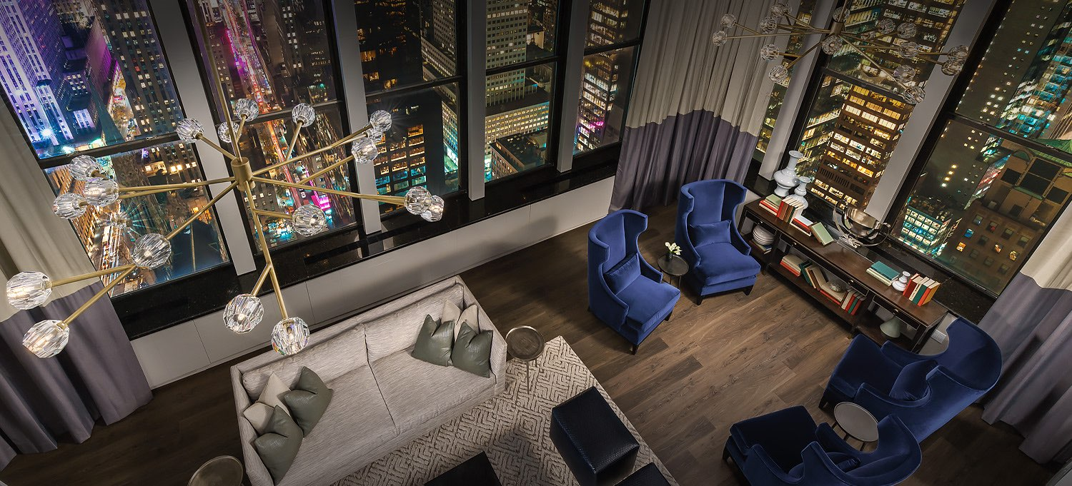 aerial view of penthouse living area and skyline