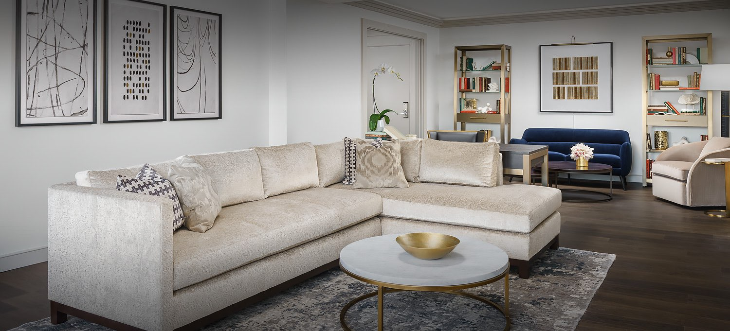 beige couch with marble coffee table