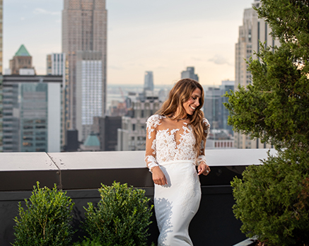 bride posing for a photo on the balcony