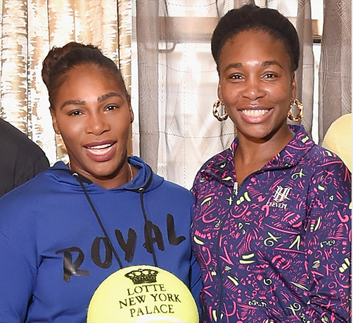 Serena and Venus Williams posing for a picture