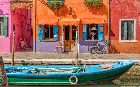 colorful exterior of building with boat