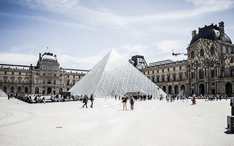 The Louvre Museum pyramid on a snowy day