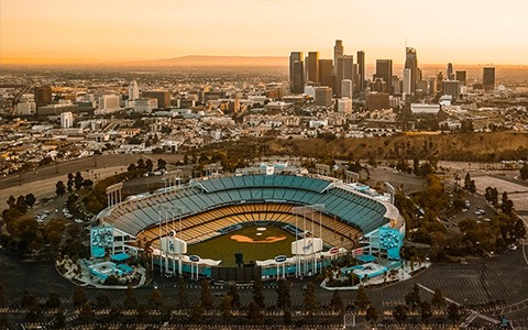 Dodger Stadium at sunset with skyline