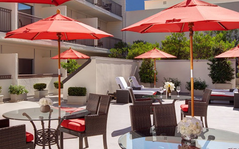 outdoor seating and dining with red umbrellas