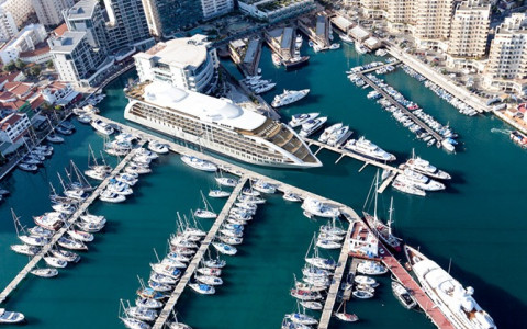 aerial view of yacht docked in marina with other boats