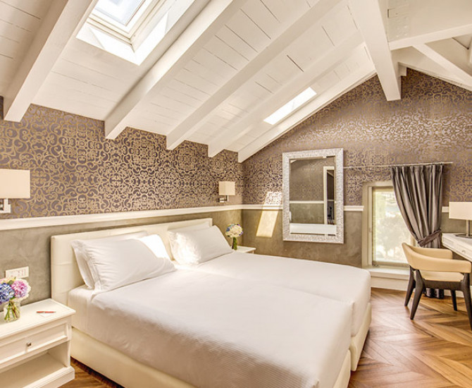 white bedroom with vaulted ceiling and skylight