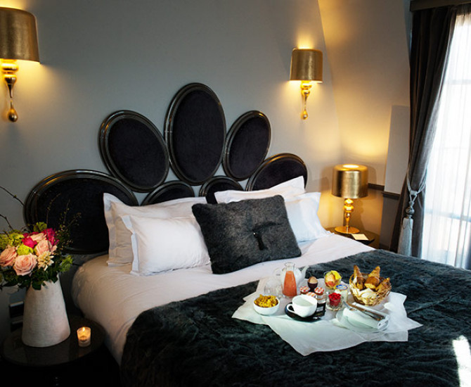 black bed with a tray of food on top