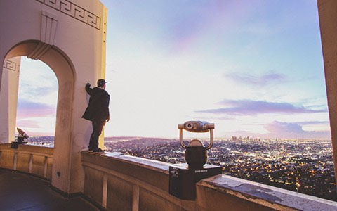 person standing at observatory looking out to city