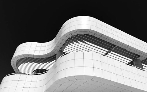 curvy white building