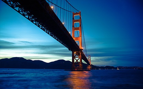 Golden Gate Bridge at dusk overlooking water