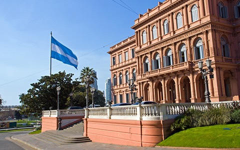 argentina flag outside of orange building