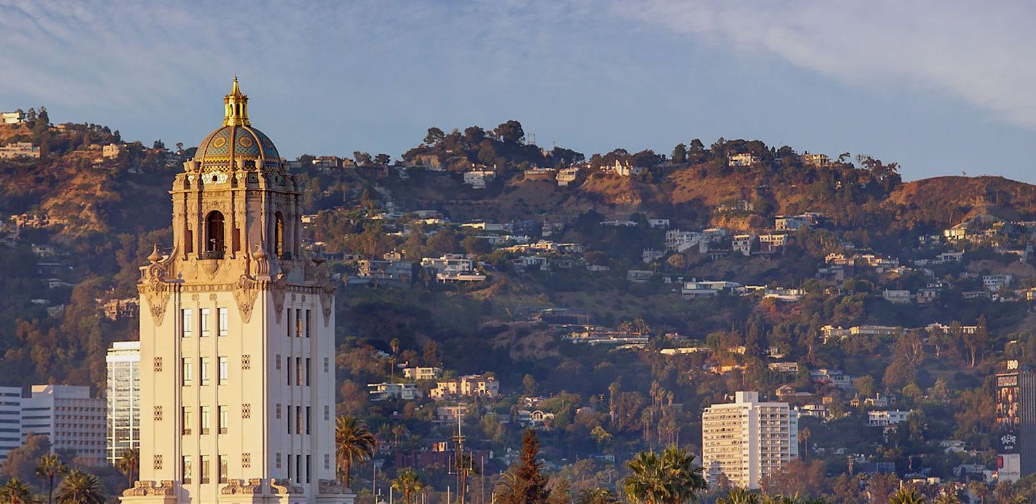 City Hall tower against a hillside filled with various buildings