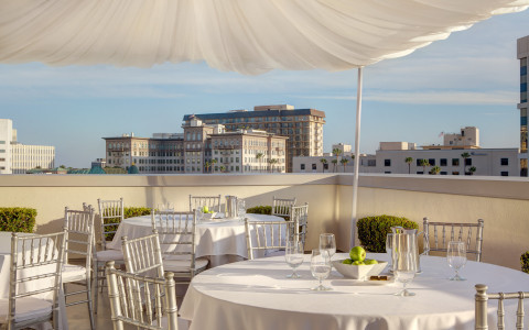 Rooftop with round tables set for reception